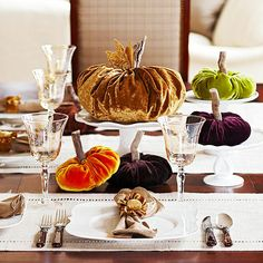 Make these paper or velvet pumpkins to add modern fun to a traditional Thanksgiving table. Plus get more fall table decorating ideas!