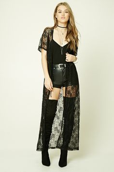 A semi-sheer lace kimono featuring an open front with an elasticized self-tie waist, short sleeves, and a longline silhouette.