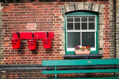 Classic period railway station red buckets and green bench