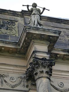 statue of piper on rear of Kedleston Hall - Robert Adam