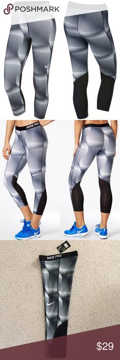 """Nike Pro Cool Capri Leggings NWT Nike women's Pro Cool Pyramid-Print Capri Leggings. Mid-rise, skinny fit with elastic waistband. Mesh inserts at bottom back of leg and sweat-wicking material. Appx: 26 1/2"""" inseam. Poly/spandex. NWT-brand new, never worn, excellent condition. Nike Pants Capris"""