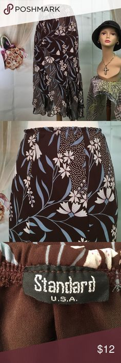 "Standard Brown Floral Skirt Today, featuring in Kaki Jo's closet is this cute brown floral skirt.  Hem is asymmetrical.  New condition.  Size S.  Waist 24 and length is 31"". Standard Skirts"