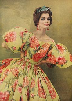 April Harper's Bazaar 1959    Celadon green silk massed with china pink roses is given a wide latitude of line - a great burst of sleeve, a gathering of greatness of skirt. By James Galanos.