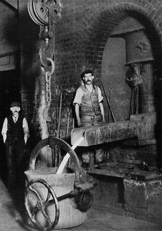 Two men working in an iron foundry.