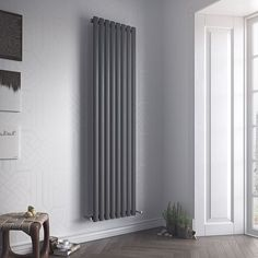 Eucotherm Nova Tube Vertical Designer Radiator - a single or double vertical oval tube radiator available in a white or anthracite finish. Central Heating System, House Design, House, Interior, Radiators Modern, Home, New Homes, Vertical, Vertical Radiators