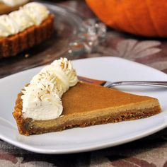 Bailey's Irish Cream Pumpkin Tart - just in time to celebrate Thanksgiving with our American friends, this delicious tart has a creamy pumpkin spice filling on a graham crumb crust and is topped with some luscious Bailey's Irish Cream Whipped Cream. A perfect end to Thanksgiving dinner or any Autumn meal.