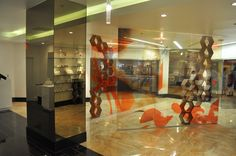 Hormeta flagship store by Tima Winter Inc. Visual Merchandising, Branding, Cosmetic Companies, Black Mirror, Design Furniture, Retail Design, Showroom, Entrance, Las Vegas
