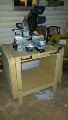 Compound Miter table wth fold up side tables.