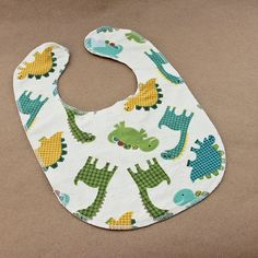 Dinosaur Baby Bib- Available in Sizes Small Medium and Large. $5.50 each