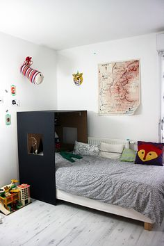 Simple custom headboard hideaway nook in a kid's room