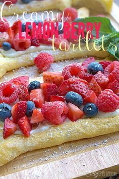Creamy Lemon Berry Tartlets, Crescent roll dough topped with sweetened cream cheese that is flavored with fresh squeezed lemon juice, topped with the freshest berries and sprinkled with powdered sugar.