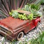 fundemento.com uses junk shop finds as creative planters. Should I pin this on garden or flea market?