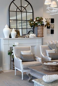 Linen chairs in front on white mantle.