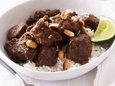 This Indonesian beef classic is wonderfully rich and fragrant. Top it with a crunchy hit of peanuts. Curry Recipes, Wine Recipes, Indonesian Fried Rice Recipe, Beef Rendang Recipe, Kaffir Lime, Beef Short Ribs, Dutch Recipes, Lime Wedge, Lemon Grass