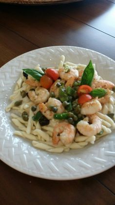 Shrimp Alfredo with capers, sundries tomatoes and peppers