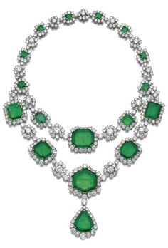 Magnificent emerald and diamond necklace, Harry Winston, 1959. Composed of a line of step-cut emeralds framed with brilliant-cut diamonds, alternating with similarly cut diamond motifs, the front highlighted with a detachable line of emeralds and brilliant-cut diamonds, suspending a detachable pendant set with a pear-shaped emerald, surrounded with brilliant-cut diamonds, unsigned, maker's mark for Tavernier. #Retro #HarryWinston #necklace