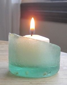 a sea glass bottle bottom makes a charming candle holder