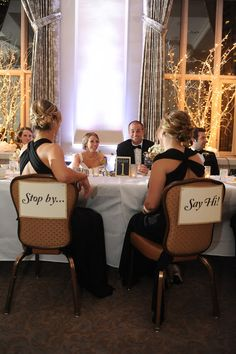 Having empty chairs across from the bride and groom is a Scandinavian tradition I first saw at a wedding in Seattle last year, where the bride and groom chose to incorporate traditions from the groom's native Sweden. There, the signs aren't necessary, guest just know that they are invited to come and chat.