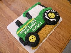 Cake is carved from a half sheet cake. Tires are...