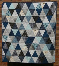 Blue and grey triangle quilt by Hil C
