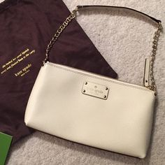 FLASH SALE ! NEW Kate Spade bag never worn! Off-white shoulder bag. Small strap with gold hardware chain strap. Zip top closure. This measures 10 inches across the bottom and the gold chain strap is 6 inch (each side plus the 8 inch shoulder strap across the top)! Comes with dust bag and Kate Spade card that came in the bag. 100% AUTHENTIC AS ALWAYS!! kate spade Bags