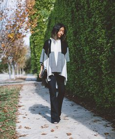 Stephanie Liu of Honey & Silk is a 70s dream girl in her 7 For All Mankind Tailorless Pintuck Trousers