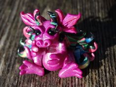 Created on the Coast of Oregon! My dragons are Inspired by the forest all around me & the beautiful flowers that l grow year round!This baby dragon is a very unique & special creature, there is only one like her in the world!   eBay!