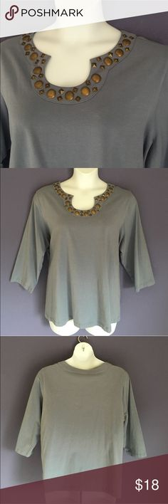 "Lark Lane Top w/Embellished Neckline This blue/gray top is so pretty. The embellished neckline adds a little drama to a plain shirt.  Pair with jeans and you have a great weekend outfit.  Material: 95% Cotton/ 5% Spandex.   Measurements: Length - 27""/Bust - 28.5"" Lark Lane Tops"