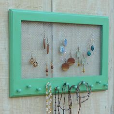 @Pamela Carlo I thought that John could make me something like this but with a small shelf above the knobs :)    Cottage Chic Distressed Jewelry Organizer by oakstudiosofdesign, $37.00