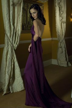 Halter neck and bare back evening dress? Yes, please. Bond girl Eva Green shows the world how to work it in Casino Royale.