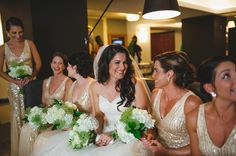 bride laughing and having fun with bridesmaids at Tampa hotel Le Meridien