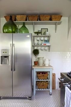 baskets above cupboards to store infrequently used items like tea cups, seasonal dishes