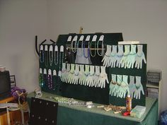 Awesome idea to display bracelets and show what they'd look like on!   Bracelet and Necklace Display by jessicasmutek, via Flickr