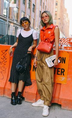 Clara Cornet in Balenciaga boots and Gia Seo in Courrèges top. On the street at New York Fashion Week. Photographed by Phil Oh.