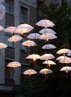 Umbrellas aloft with tiny flames