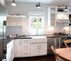 Like hardware and cabinets.  Not sure about sink.  Countertop too dark.  Maybe not open shelves to same extent shown here