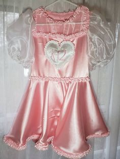 This pretty baby pink dress features a heart patch on the front, organza sleeves and chest, and ruffles around the skirt and waist. Each dress is made to order and your measurements, that includes plus size! Melanie Martinez Dress, Melanie Martinez Concert, Moda Aesthetic, Looks Kawaii, Baby Pink Dresses, Cool Outfits, Fashion Outfits, Fashion Ideas, Uniform Dress