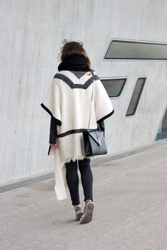 SOUTHWESTERN | Fiona from thedashingrider.com wears Saint Laurent Monogramme Bag, Topshop Leigh Jeans, Western Poncho and Chucks.
