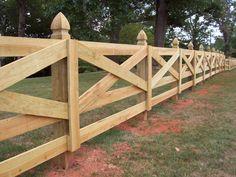 Custom wood crossbuck horse fence design by Mossy Oak Fence Company