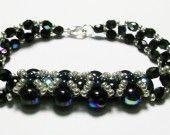 bracelet noir et reflets    http://www.alittlemarket.com/bracelet/bracelet_noir_et_reflets-1758463.html