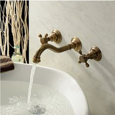 Antique Brass Bathroom Sink Tap Wall Mount Double Handle ... https://www.amazon.co.uk/dp/B00KBKZ630/ref=cm_sw_r_pi_dp_x_8LzZybXBZHMA5