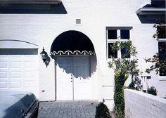 Dome awning with applique and tassels