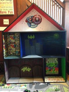 """My first pin worthy project! Matt built this """"dollhouse"""" and I painted and transformed into a superhero castle for Bryce! So excited the way it turned out!"""