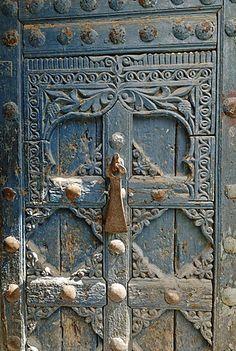 Historic door in the old town of Al Mukalla, Mukalla, Yemen Door Knockers, Woodcarving, German Shepherd Dogs, Old Town, Barns, Maya, Remote, Old Things, Doors