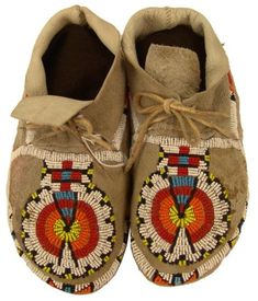 """Cheyenne Moccasins Traditional pair of sinew sewn and lazy stitch beaded commercial hide moccasins with classic medallion design on vamps. Very good condition. Circa: 1980s Size: 9"""" Estimate: 250.00 - 500.00 Auction Has Concluded: Price Realized: 95.00"""