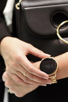 Street style for the girl who's always on-the-go. Who says you have to choose between functionality and style? This Q Wander smartwatch is the rose-gold tech gadget you've been looking for.