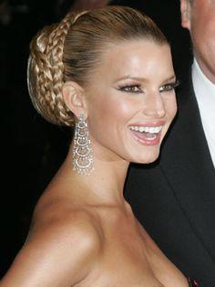 Jessica Simpson does a beautiful elegant braided bun. Adding hair helps to create a full shape to the bun