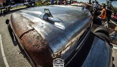 1957 Chevy car hood flipped around and used as a ratrod roof panel including hood bullet trim