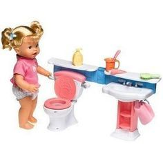 Little Mommy Gotta Go Doll - retired - bought on Ebay to use as toilet and sink in American Girl bathroom. Looks cute and the doll is a hit too (she pees and poops and brushes her teeth - pretty funny)