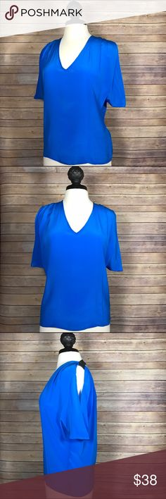 Sylk Sophia Open-back Blouse Top $88 The Sophia Top by Sylk features a scoop neck, relaxed fit, scoop back with a horizontal strap at the top, and short sleeves with ruched detailing at the top. 100% silk.                          Condition: New without tags. Never worn. Sylk Tops Blouses